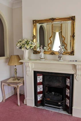 Victorian Suite - living area with gas fireplace